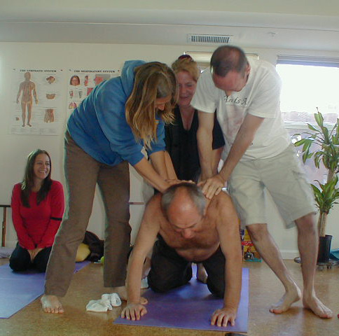 Meir demonstrating the stregth of his back with students